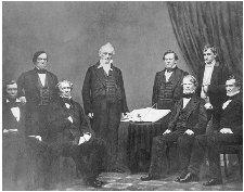 President Buchanan (center) surrounded by his cabinet. Seated left to right are Jacob Thompson, John B. Floyd, Isaac Toucey, and Jeremiah Black. Standing left to right are Lewis Cass, Howell Cobb, and Joseph Holt. BETTMANN/CORBIS