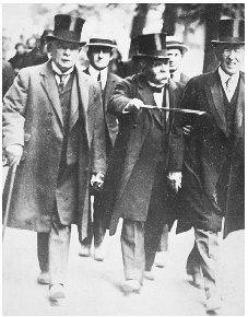 President Wilson (far right) strolls with David Lloyd George of Great Britain (far left) and Georges Clemenceau of France during the Paris Peace Conference following World War I. ARCHIVE PHOTOS