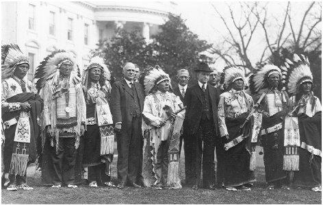President Calvin Coolidge (wearing hat) welcomes representatives of the Sioux tribe to the White House in 1925. THE LIBRARY OF CONGRESS