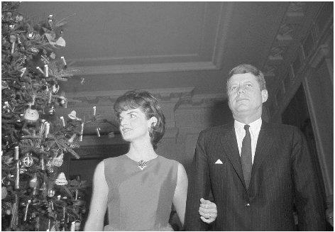 President John F. Kennedy and First Lady Jacqueline Kennedy stand by the White House Christmas tree in the main entrance hall of the White House, 12 December 1962. AP/WIDE WORLD