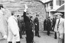 Ronald Reagan waves to supporters as he leaves a Washington, D.C., hotel, moments before he was shot in an assassination attempt on 30 March 1981. The president was rushed to George Washington University Hospital and spent eleven days there following surgery. CORBIS