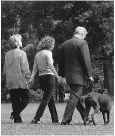 President Clinton and his family, along with dog Buddy, walk across the south lawn of the White House in 1998. AP/WIDE WORLD